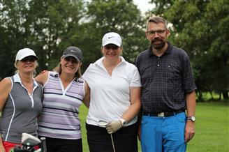 Vier Golfer beim posieren