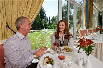 Couple eating in the conservatory